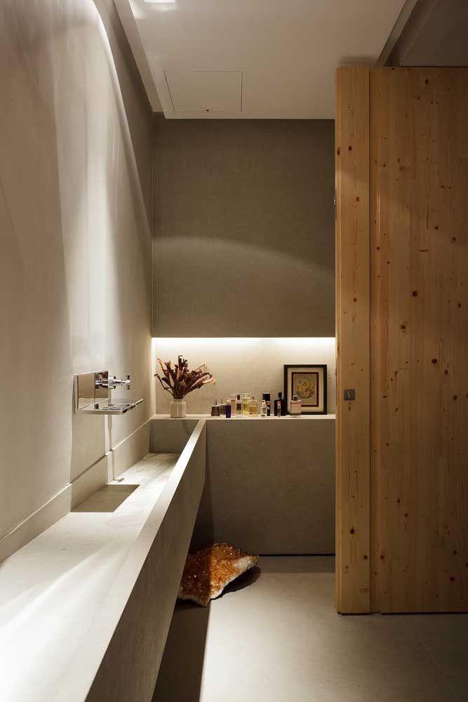 O nicho garante a continuidade visual da pia esculpida, garantindo o efeito linear, clean e moderno para o banheiro
