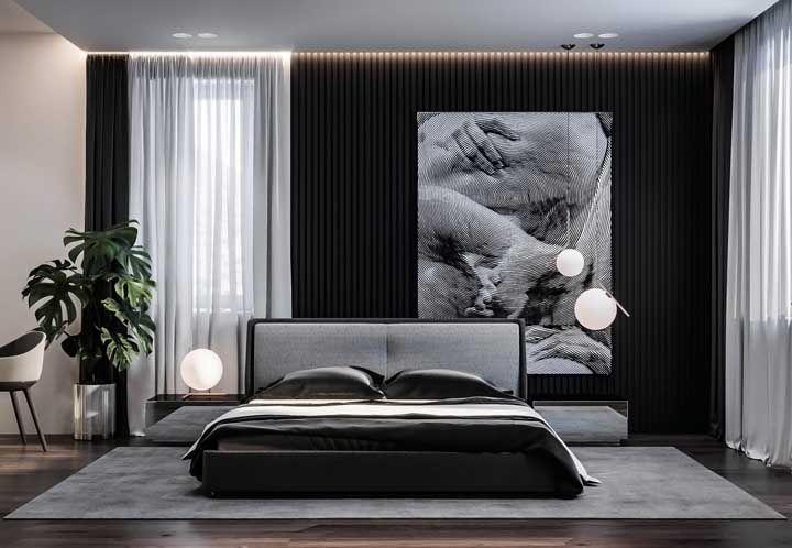 Um quadro de efeito ótico de tamanho grande para preencher a parede atrás da cama