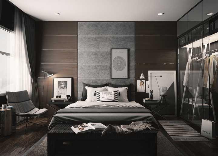 Um quarto e várias formas de usar quadros: na parede, no chão e sobre o criado mudo
