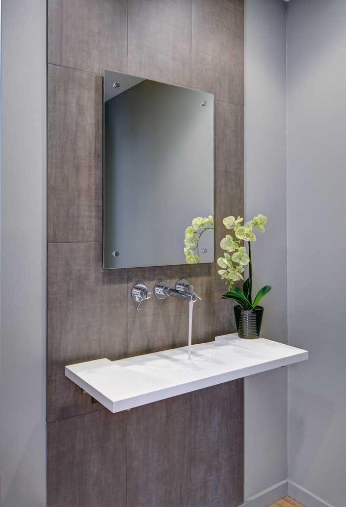Uma cuba simples feita em Corian, mas capaz de encher o seu banheiro de beleza e elegância