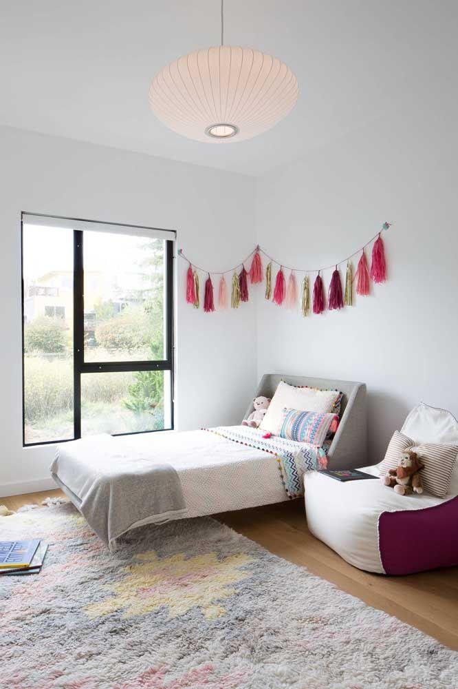 Tons suaves e delicados no tapete para combinar com o restante do quarto infantil