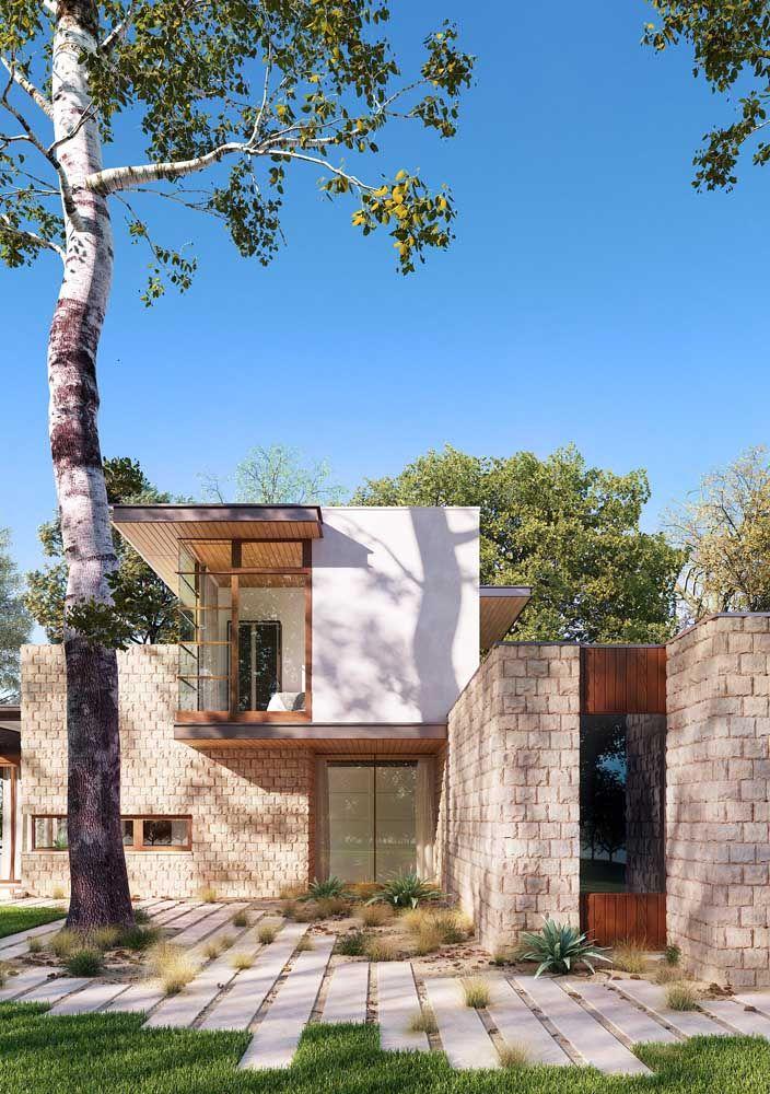 Linhas retas, janelas amplas e mix de materiais na fachada dessa casa de estilo contemporâneo
