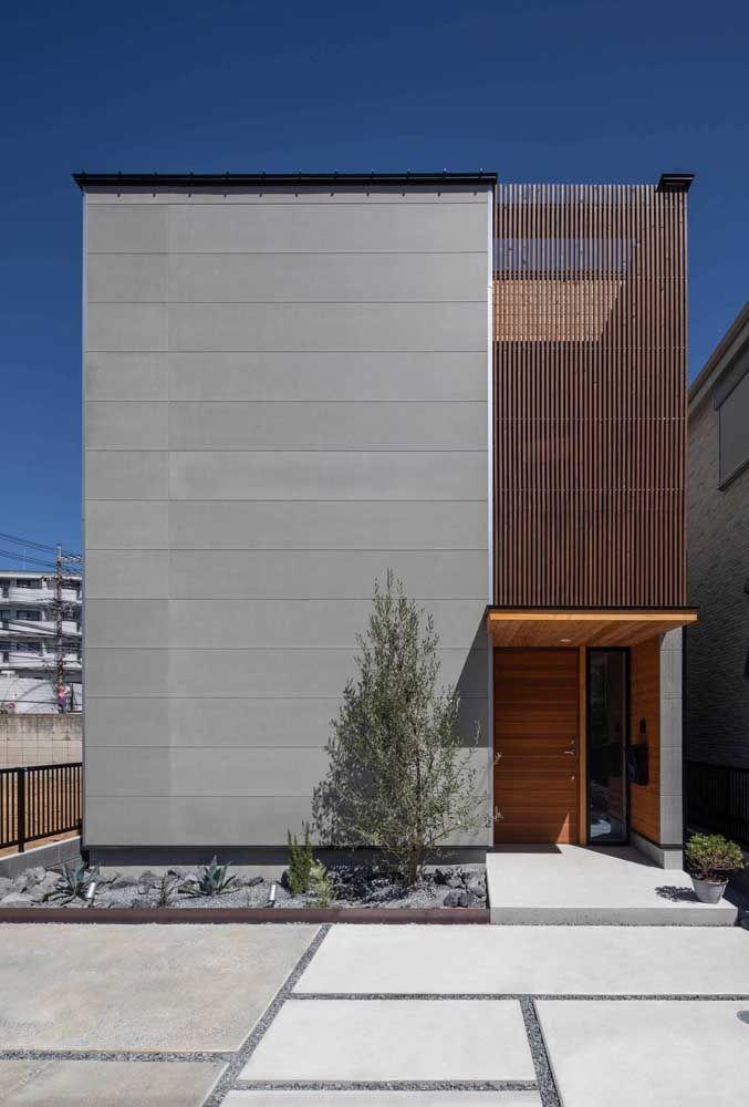 Minimalismo e mix de materiais nessa fachada