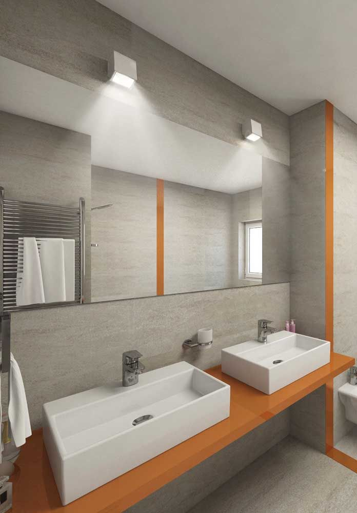Dessa vez, o laranja ganhou espaço no ambiente em uma proposta ousada e original
