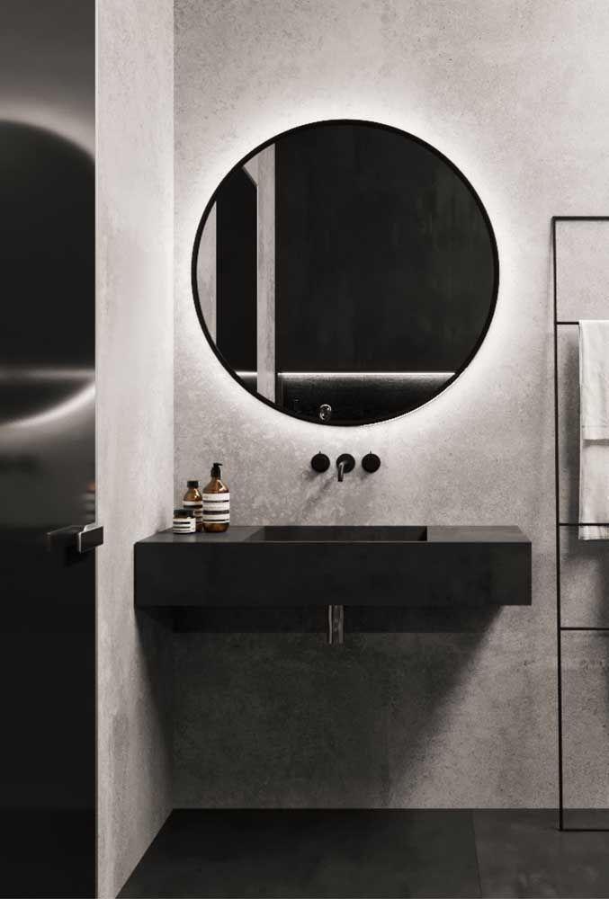 Pia em Marmoglass preto combinando perfeitamente com o estilo moderno do banheiro