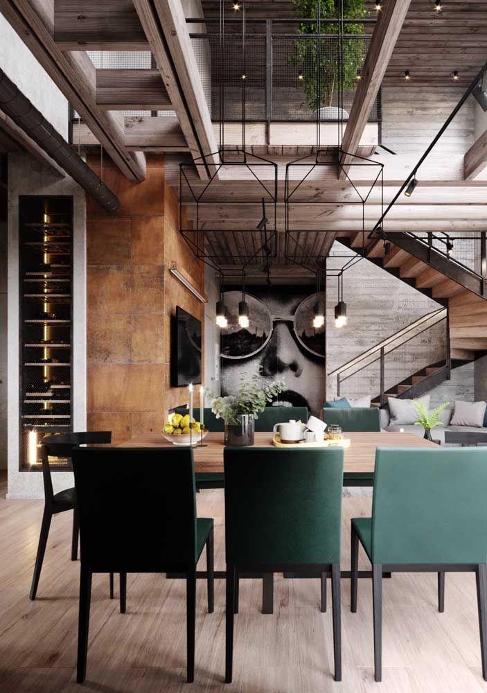 O moderno e o industrial marcam presença nessa sala dois ambientes ampla, arejada e com pé direito duplo
