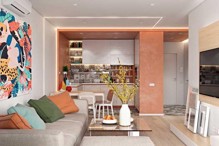 Já para quem prefere algo mais cheio de cor e vida, pode se inspirar nesse modelo de sala dois ambientes