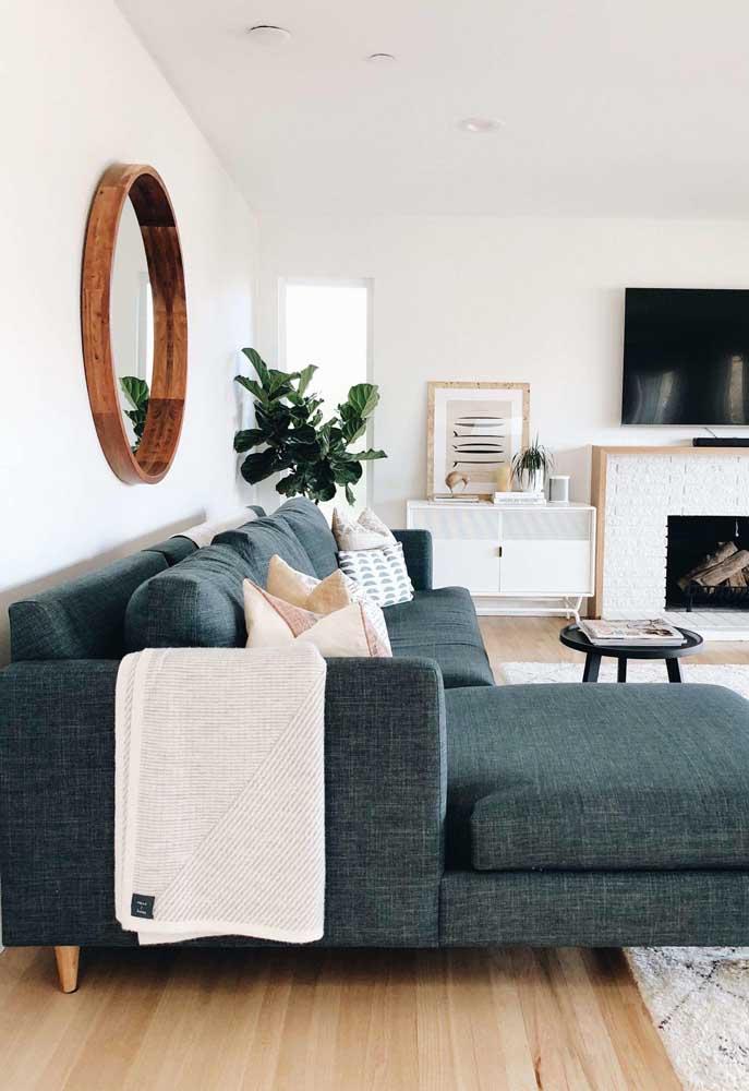 O verde azulado combinado a textura natural do tweed ficou um arraso nesse sofá