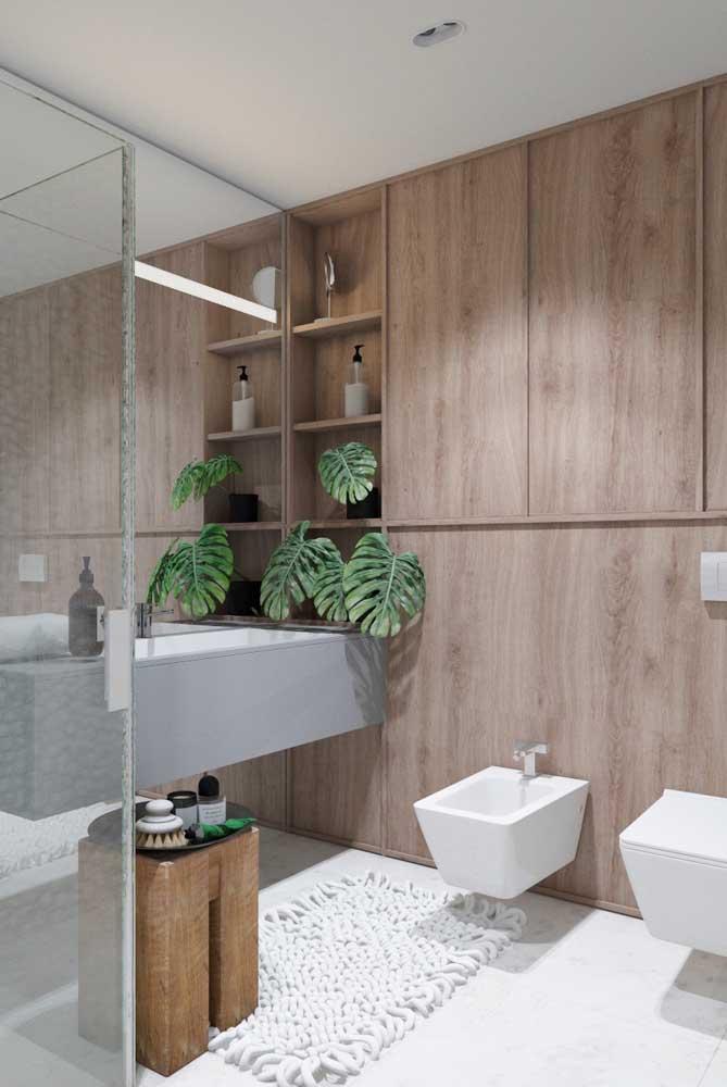 No banheiro, os nichos de parede se revelam ainda mais funcionais
