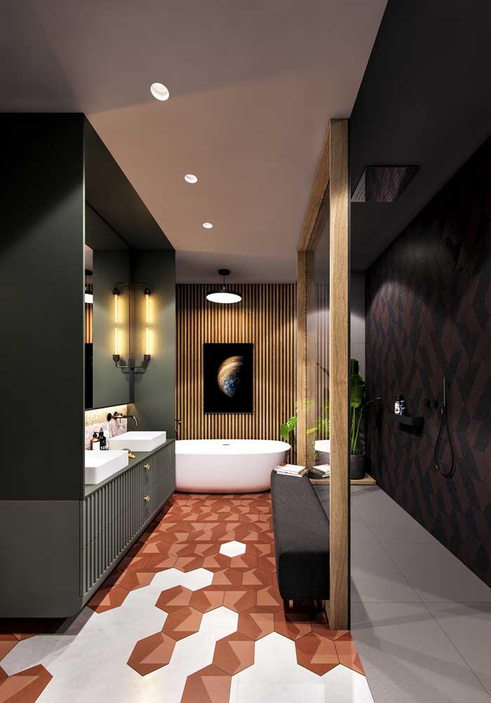 Um banheiro elegante e sofisticado que elegeu o tom de verde musgo para colorir a bancada da pia