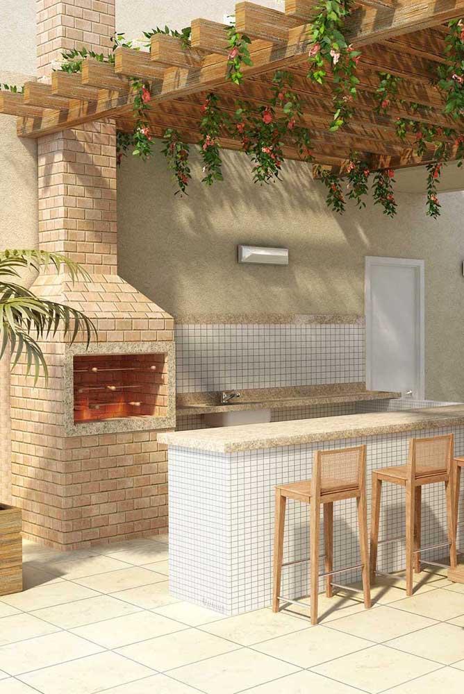 Churrasqueira de tijolo construída em espaço gourmet com destaque especial para o pergolado