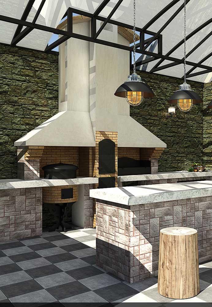 Churrasqueira de tijolos com chaminé em concreto; modelo moderno e diferenciado para o espaço gourmet