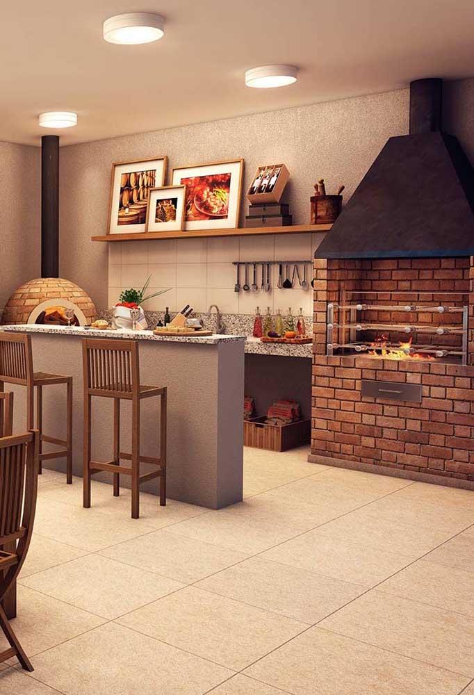Churrasqueira e forno a lenha de tijolos para o espaço gourmet super bem decorado