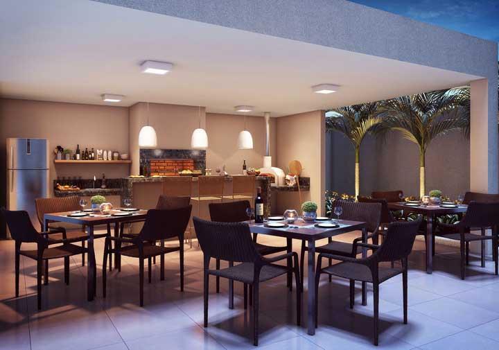 Espaço gourmet elegante com churrasqueira de tijolo de largura ampla