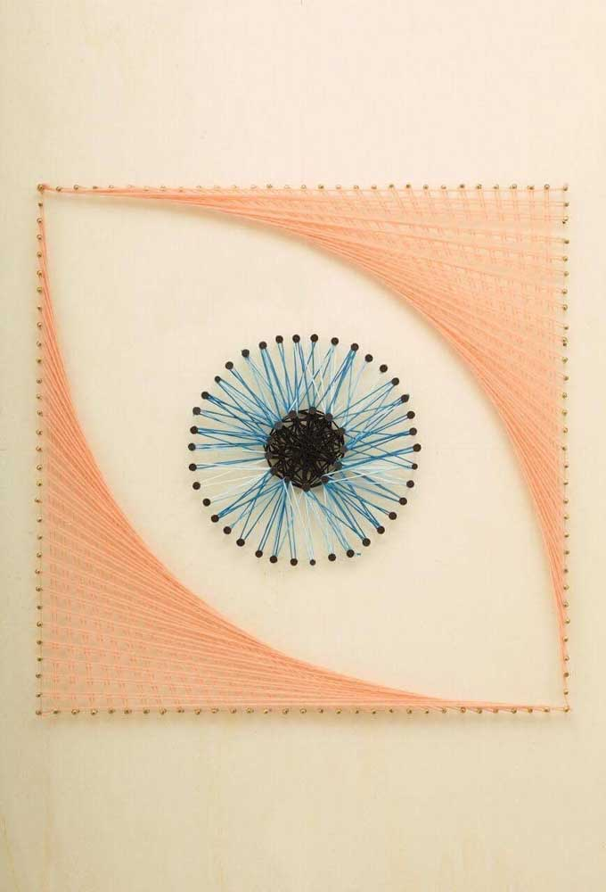 Olho em String Art aplicado diretamente na parede do ambiente