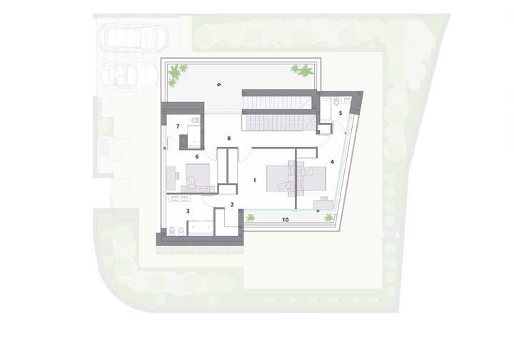 Aqui vemos o segundo andar da casa, com dois quartos e uma suíte máster