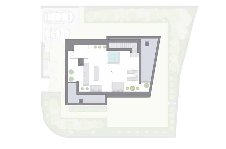 Já no terceiro andar da casa, um espaço social com banheira spa