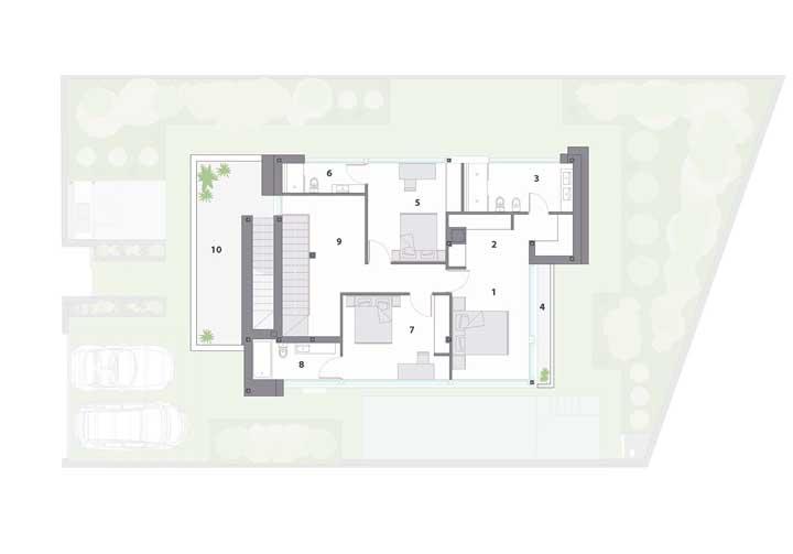 No andar superior da mesma casa é possível ver os dois quartos e a suíte máster