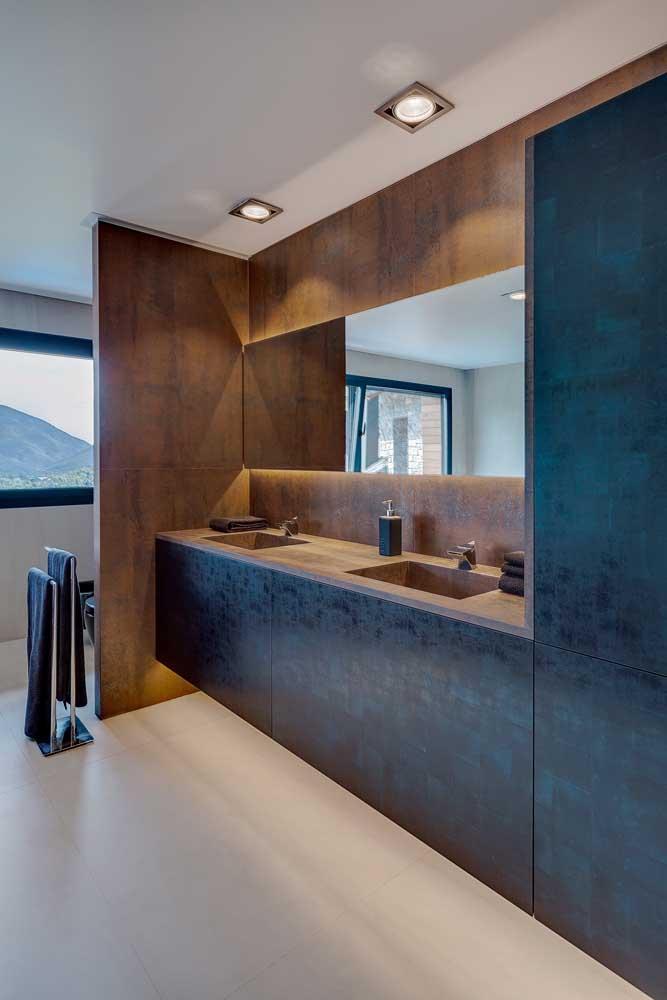 Que beleza de banheiro! O aço corten é o destaque desse ambiente