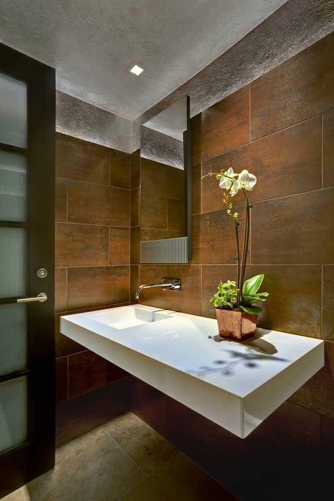 Impressione suas visitas com um lavabo revestido em aço corten