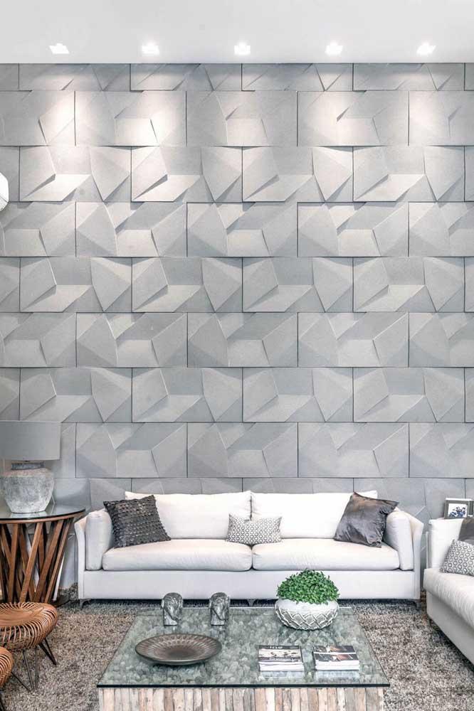 Linda inspiração de parede em 3D na cor cinza; a iluminação fecha a proposta com chave de ouro