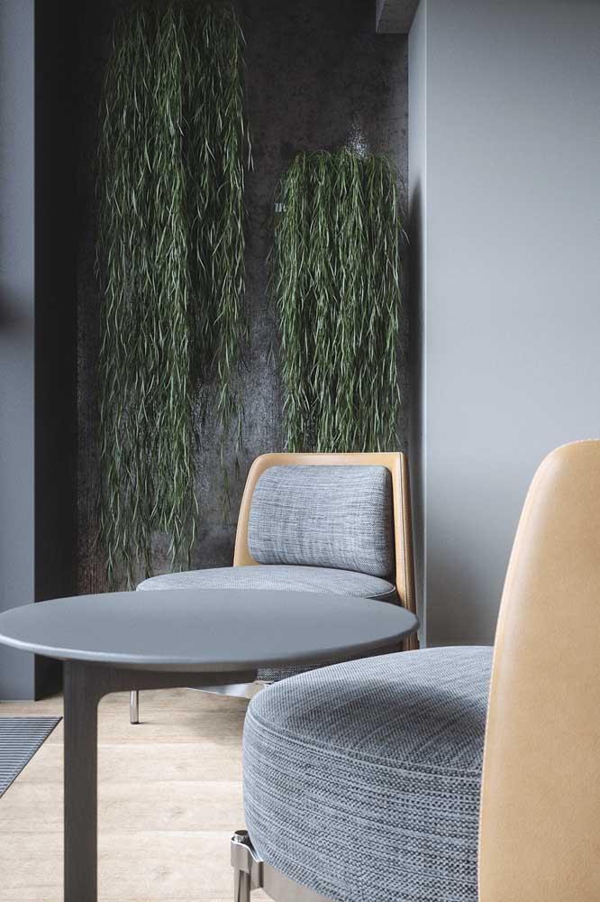 O cinza em contraste com o verde proporciona um ambiente acolhedor e relaxante