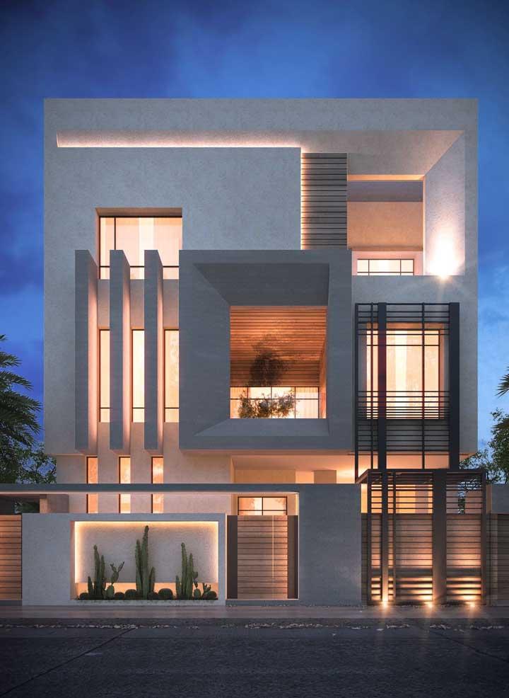 Modelo de grade clean para a fachada moderna; o tom escuro da grade frente à parede branca gerou destaque