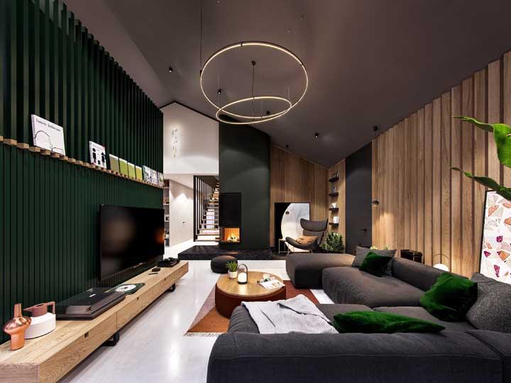 Uma sala de estar com paredes verdes que transborda elegância e modernidade