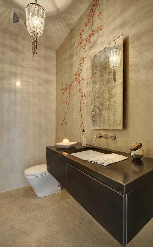 Lavabo elegante decorado com ramo de flor de cerejeira na parede