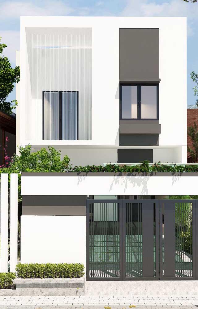 Casa elegante de alvenaria com dois pavimentos e fachada minimalista