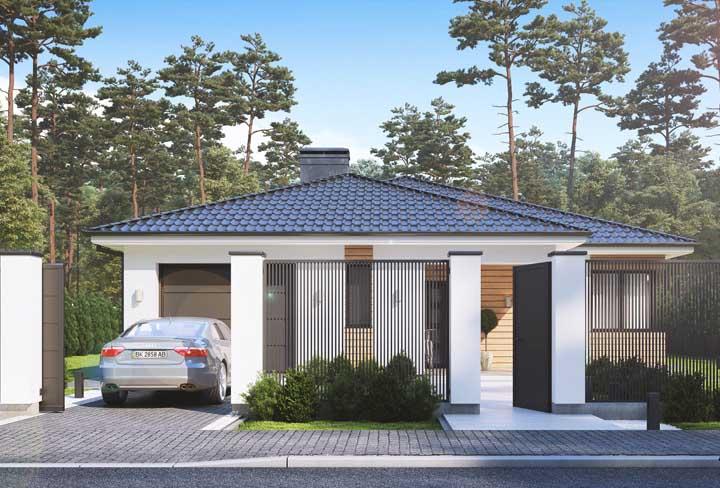 Fachada de casa de alvenaria pequena e acolhedora com entrada social e entrada da garagem