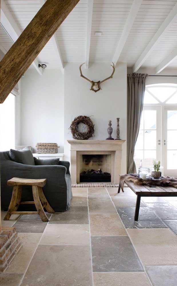 Sala de estar em estilo rústico moderno com piso feito de pedras São Tomé