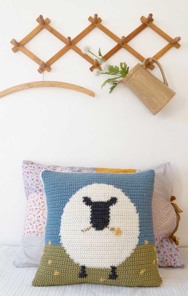 Um toque divertido na estampa da almofada feita em crochê Tunisiano