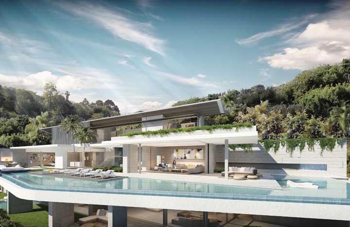 Já pensou em uma piscina contornando a fachada da casa? Nessa mansão isso é possível
