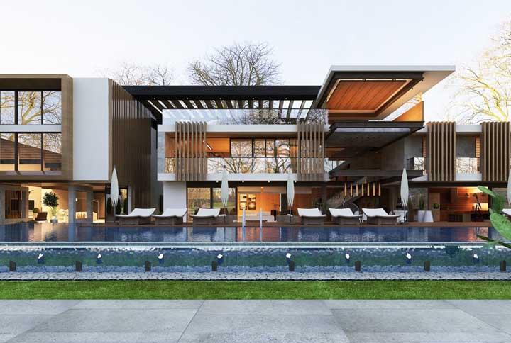 E que tal essa mansão aqui? Um projeto super moderno com uma piscina transparente que parece flutuar na entrada da casa