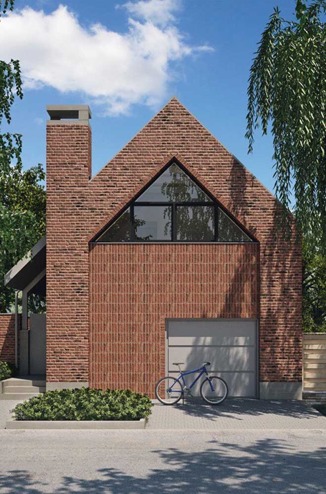 Casa de tijolo ecológico com fachada na cor natural do material