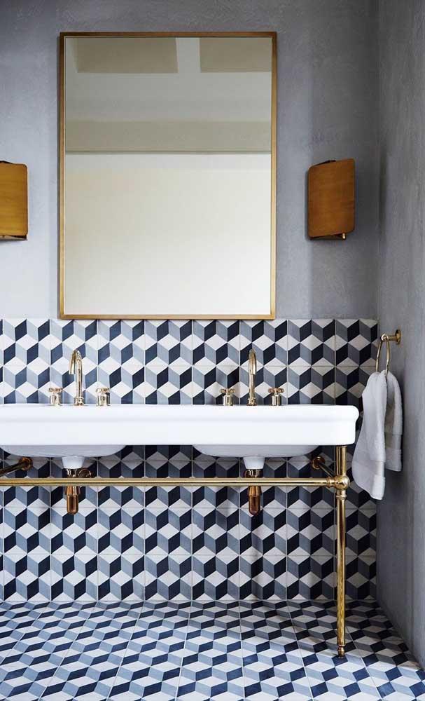 Para esse lavabo moderninho, a opção foi por um piso 3D com efeito geométrico preto e branco
