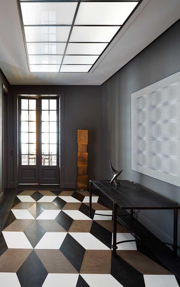 No hall de entrada, o piso 3D recebe muito bem as visitas