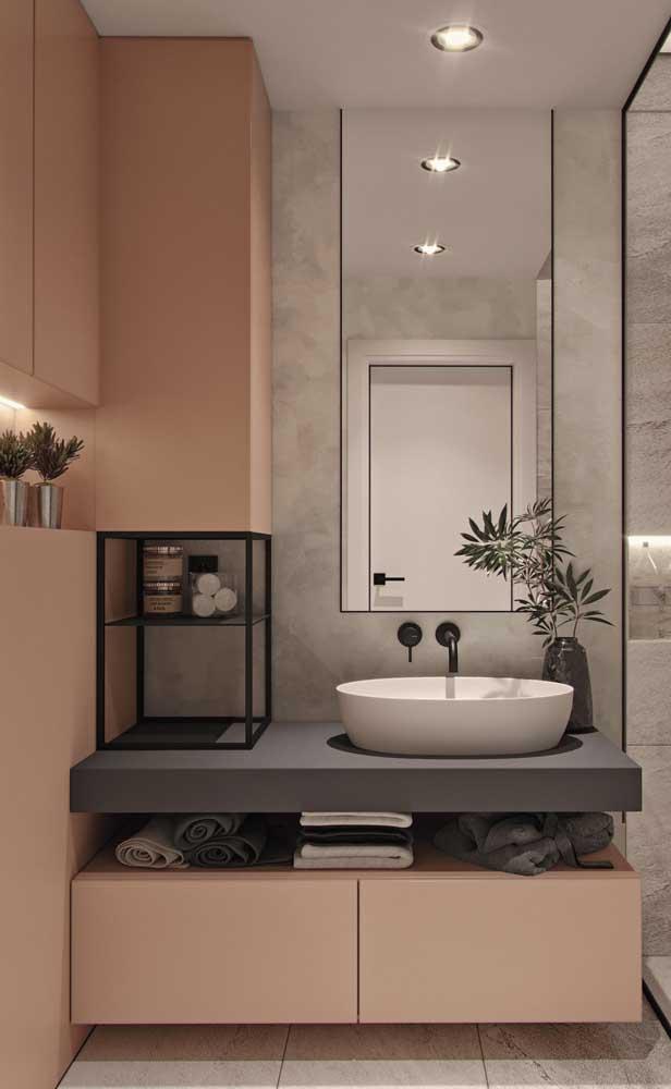 Super moderno e aconchegante esse banheiro que mescla a cor salmão com o cinza