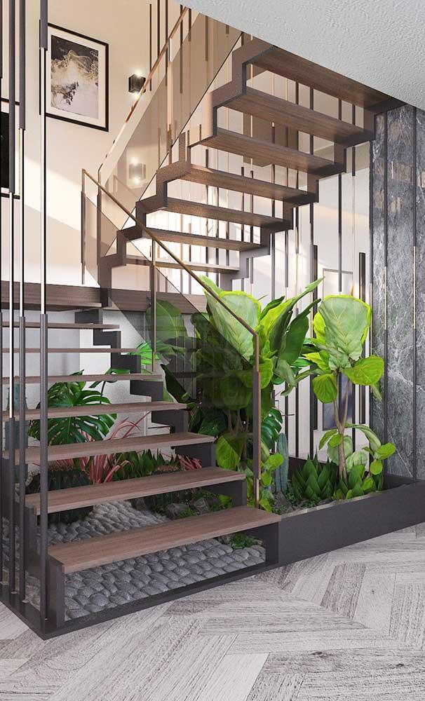 Modelo de escada moderna em U com jardim de inverno embaixo