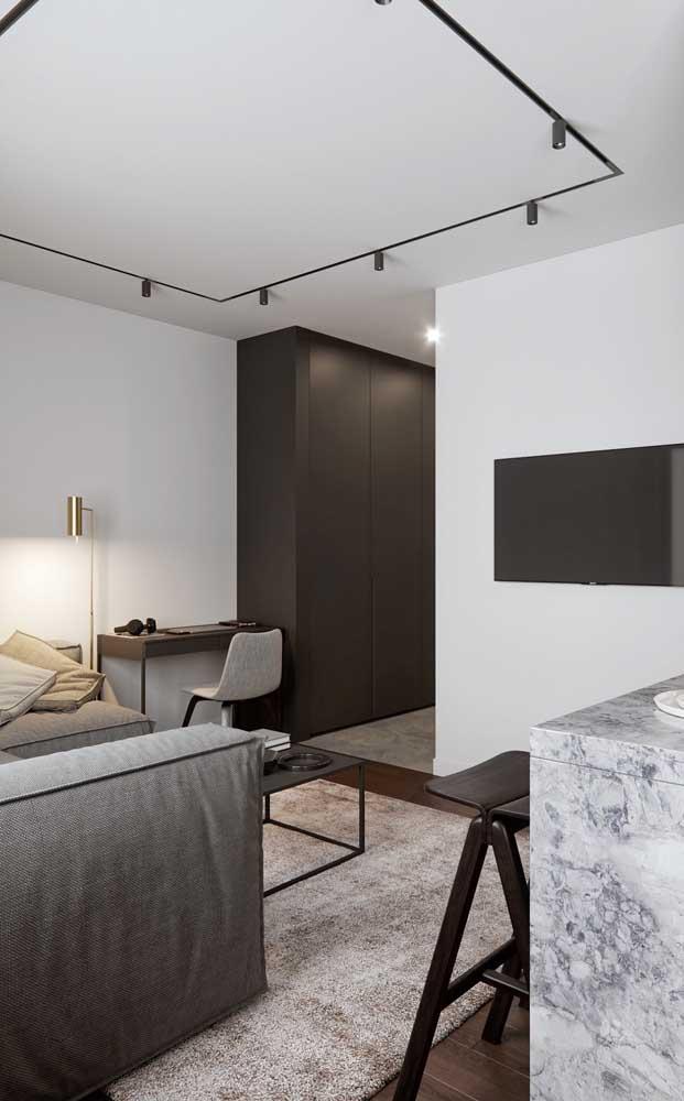 Super elegante e moderna essa sala de estar em tons de branco e preto