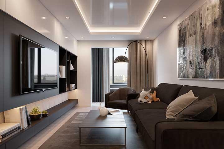 Ganha amplitude e profundidade na sala de estar optando por um rack comprido e painel