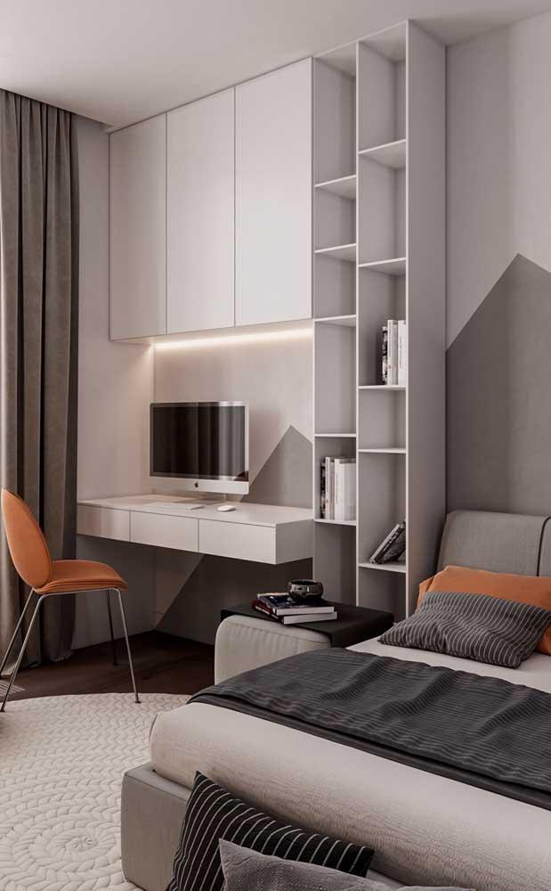 Para esse quarto de solteiro a paleta de cores escolhida foi do branco, cinza, preto e laranja