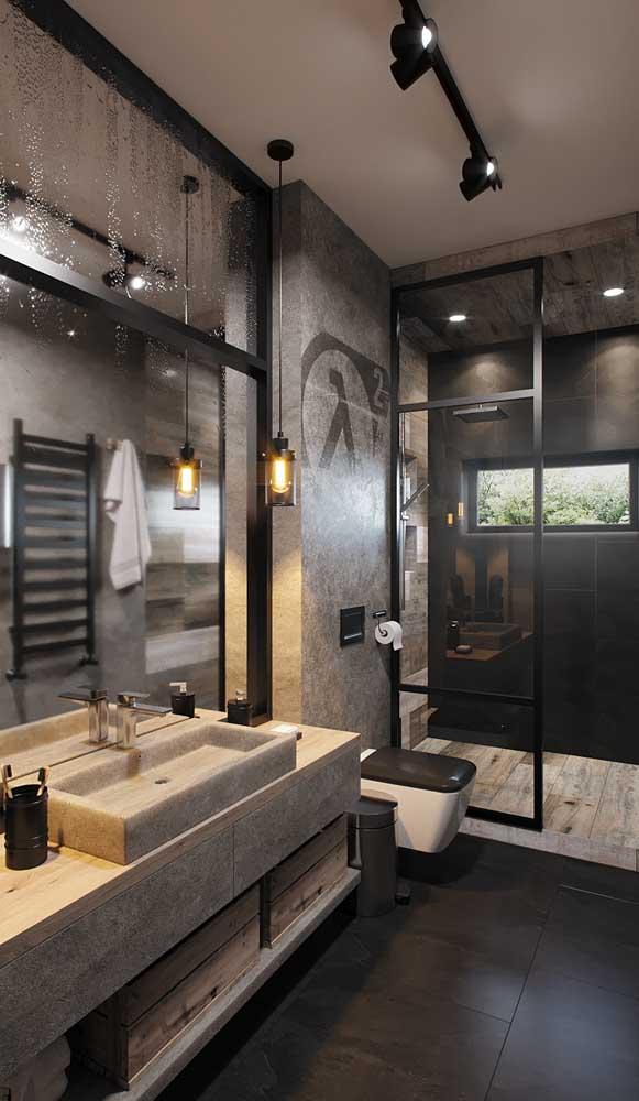Banheiro jovem e moderno decorado com luminária de lâmpada de carbono