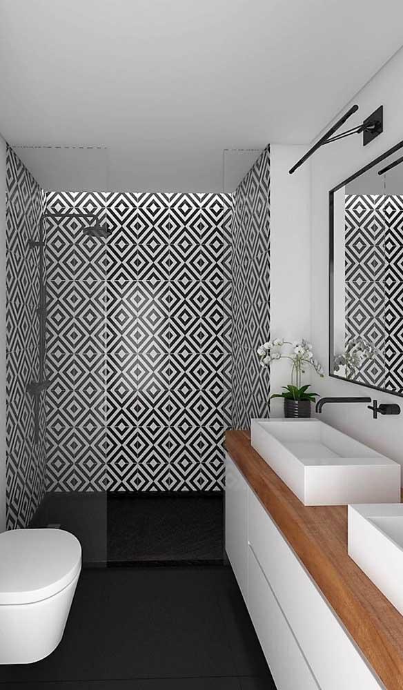 Aqui, a luminária segue o conceito do preto e branco da decoração