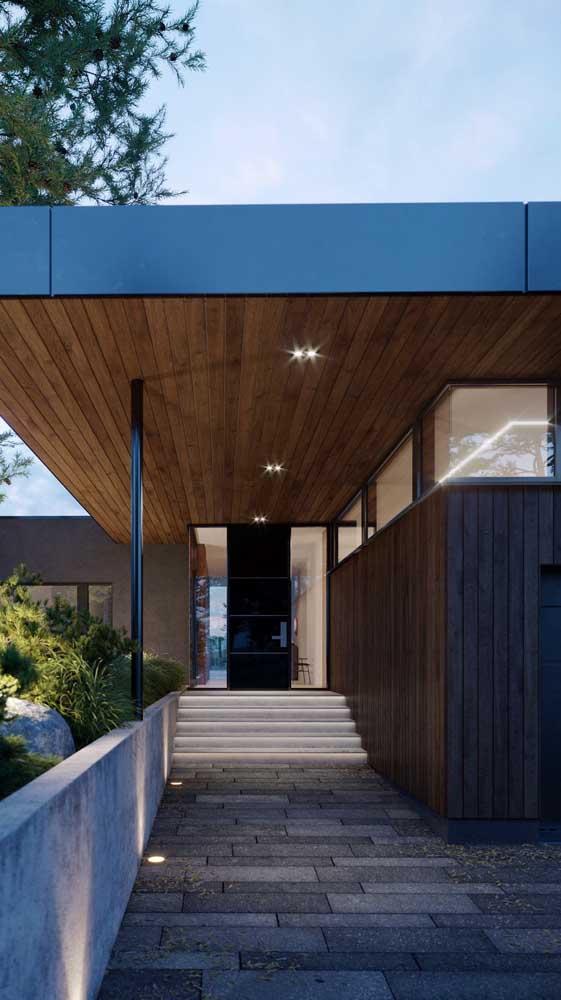 Piso intertravado para conduzir até a entrada da casa de arquitetura moderna