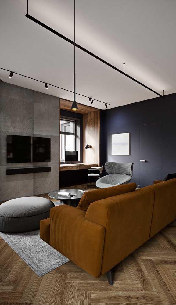 Sala de estar moderna com luminária pendente simples sobre o sofá