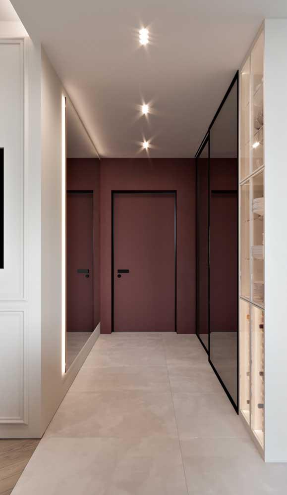 Aqui, a combinação do marsala com o preto e o uso do espelho criou um ambiente elegante e moderno