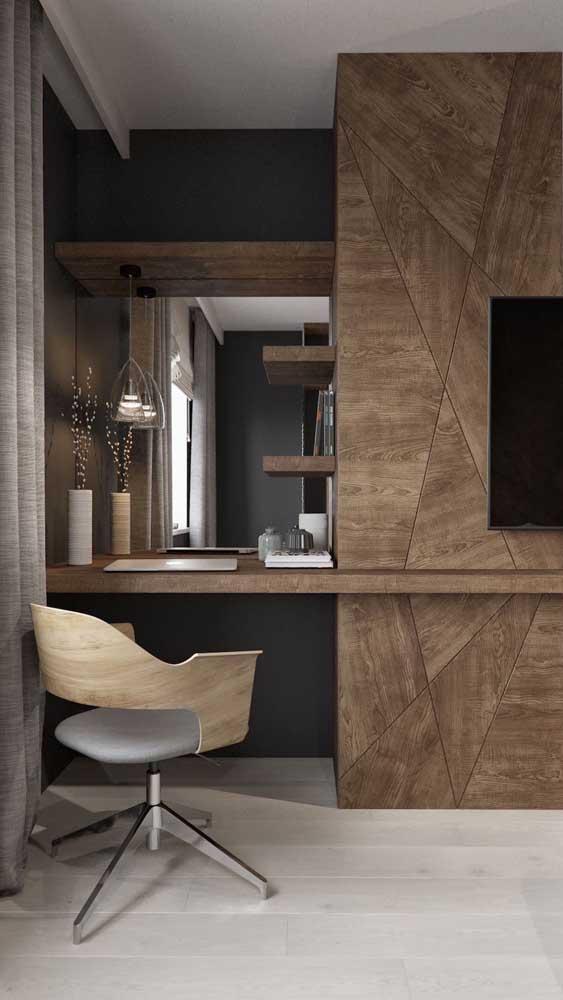 Essa escrivaninha no quarto ganhou uma cadeira giratória com base metálica super moderna