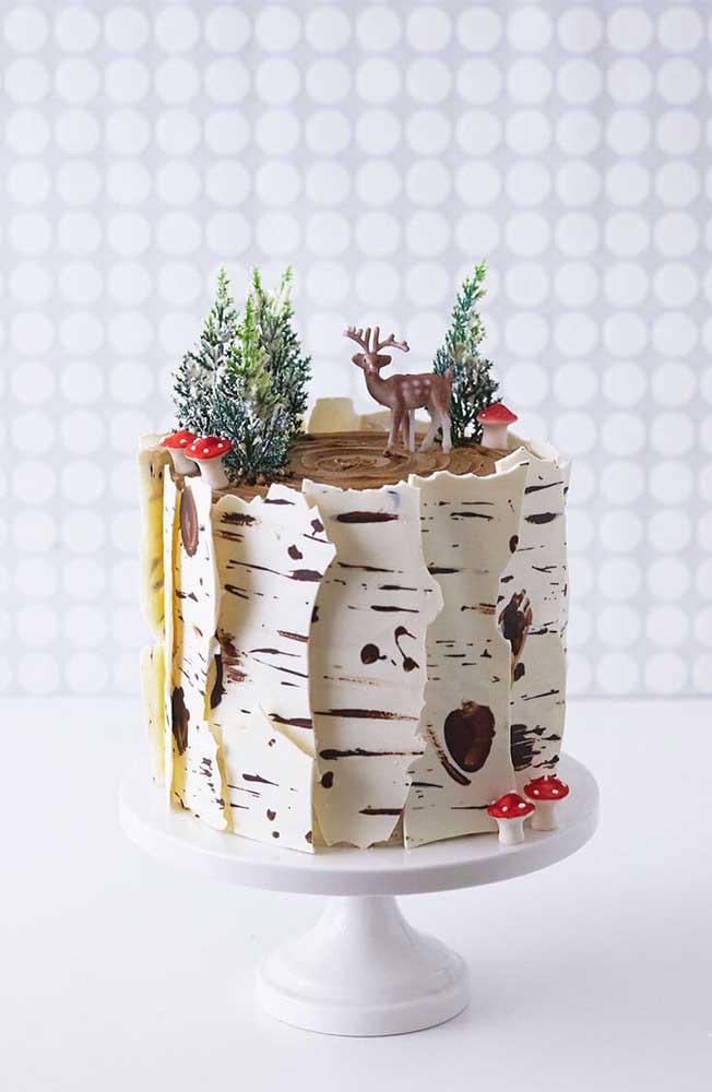 Uma mini floresta no topo do bolo de natal